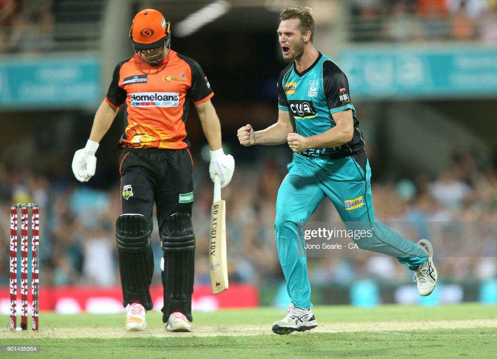 Brisbane player Mark Steketee (right) celebrates a wicket during the Big Bash League match between the Brisbane Heat and the Perth Scorchers at The Gabba on January 5, 2018 in Brisbane, Australia.