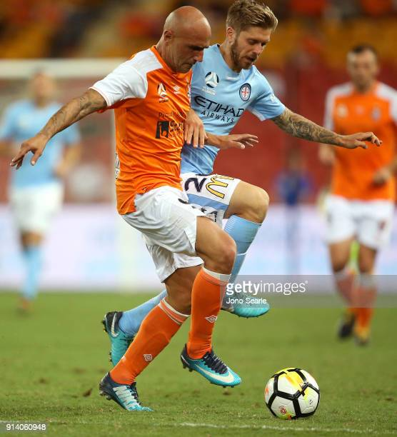 Brisbane Player Massimo Maccarone and Melbourne player Luke Brattan compete for the ball during the round 19 ALeague match between the Brisbane Roar...