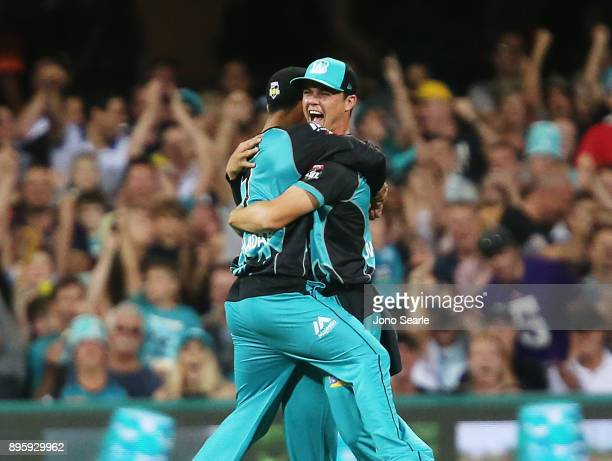 Brisbane player Mitch Swepson celebrates taking a catch during the Big Bash League match between the Brisbane Heat and the Melbourne Stars at The...