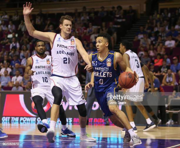 Brisbane player Travis Trice looks to get past Adelaide player Daniel Johnson during the round 13 NBL match between the Brisbane Bullets and the...