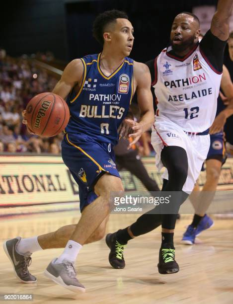 Brisbane player Travis Trice looks to get past Adelaide player Shannon Shorter during the round 13 NBL match between the Brisbane Bullets and the...