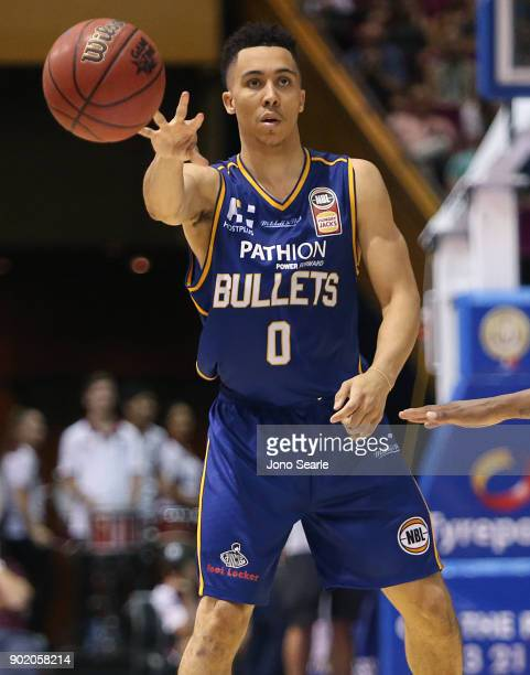 Brisbane player Travis Trice passes the ball during the round 13 NBL match between the Brisbane Bullets and the Adelaide 36ers at Brisbane Convention...