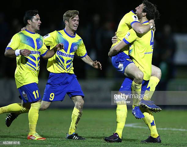 Brisbane players celebrate a goal scored in extra time during the FFA Cup match between Broadmeadow and Brisbane Strikers at Wanderers Oval on July...