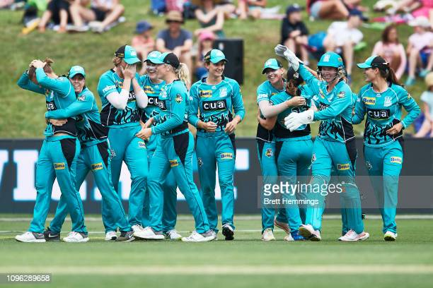 Brisbane players celebrate victory during the Women's Big Bash League match between the Sydney Thunder and the Brisbane Heat at Drummoyne Oval on...