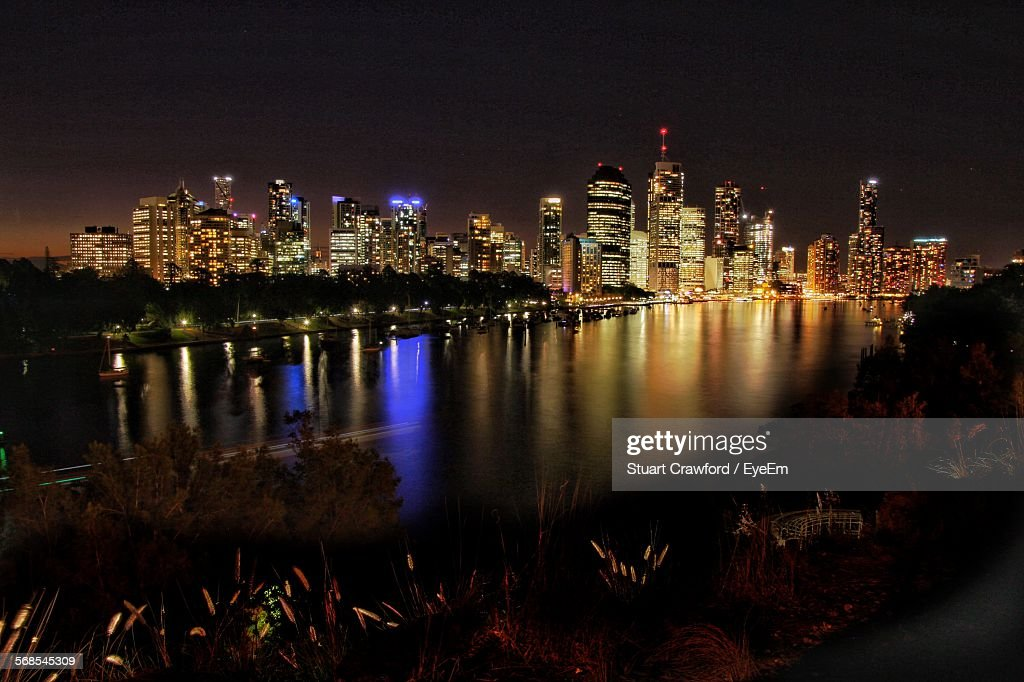 Brisbane River In Front Of Illuminated Buildings At Night : Stock Photo