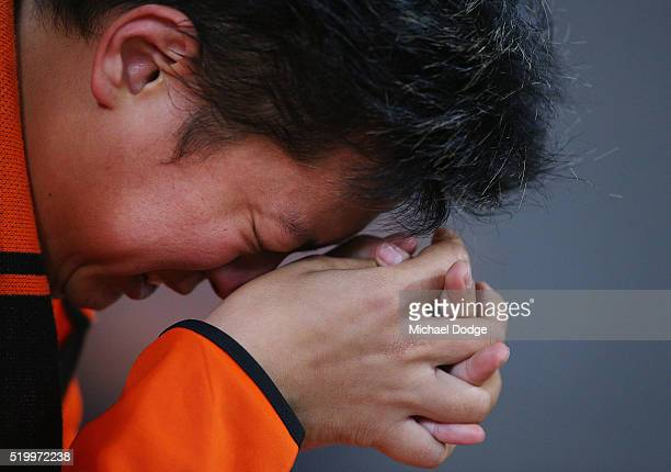 Brisbane Roar fan cries after their draw during the round 27 ALeague match between the Melbourne Victory and the Brisbane Roar at AAMI Park on April...