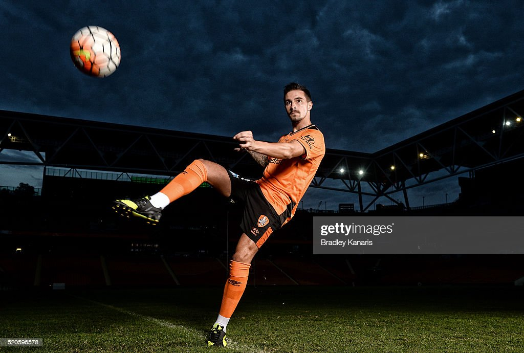Brisbane Roar player Jamie Maclaren strikes the ball during a portrait session at Suncorp Stadium on April 12, 2016 in Brisbane, Australia.