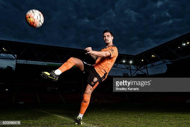 Brisbane Roar player Jamie Maclaren strikes the ball during a portrait session at Suncorp Stadium on April 12 2016 in Brisbane Australia