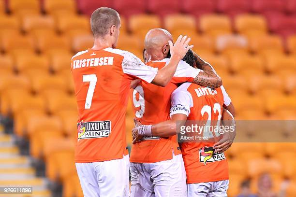Brisbane Roar players celebrate a Eric Bautheac goal during the round 22 ALeague match between the Brisbane Roar and Adelaide United at Suncorp...