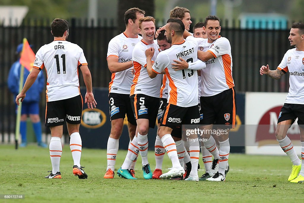 Brisbane Roar players celebrate a goal during the round 11 A-League match between the Central Coast Mariners and Brisbane Roar at Central Coast Stadium on December 18, 2016 in Gosford, Australia.