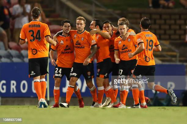 Brisbane Roar players celebrate a goal during the round 12 ALeague match between the Newcastle Jets and the Brisbane Roar at McDonald Jones Stadium...