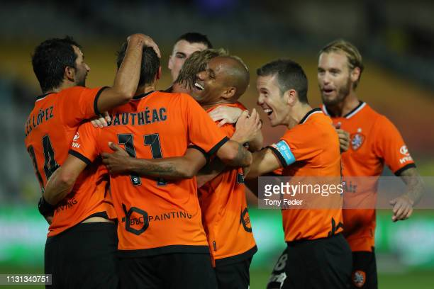 Brisbane Roar players celebrate a goal during the Round 20 ALeague Match between the Central Coast Mariners and Brisbane Roar FC at Central Coast...