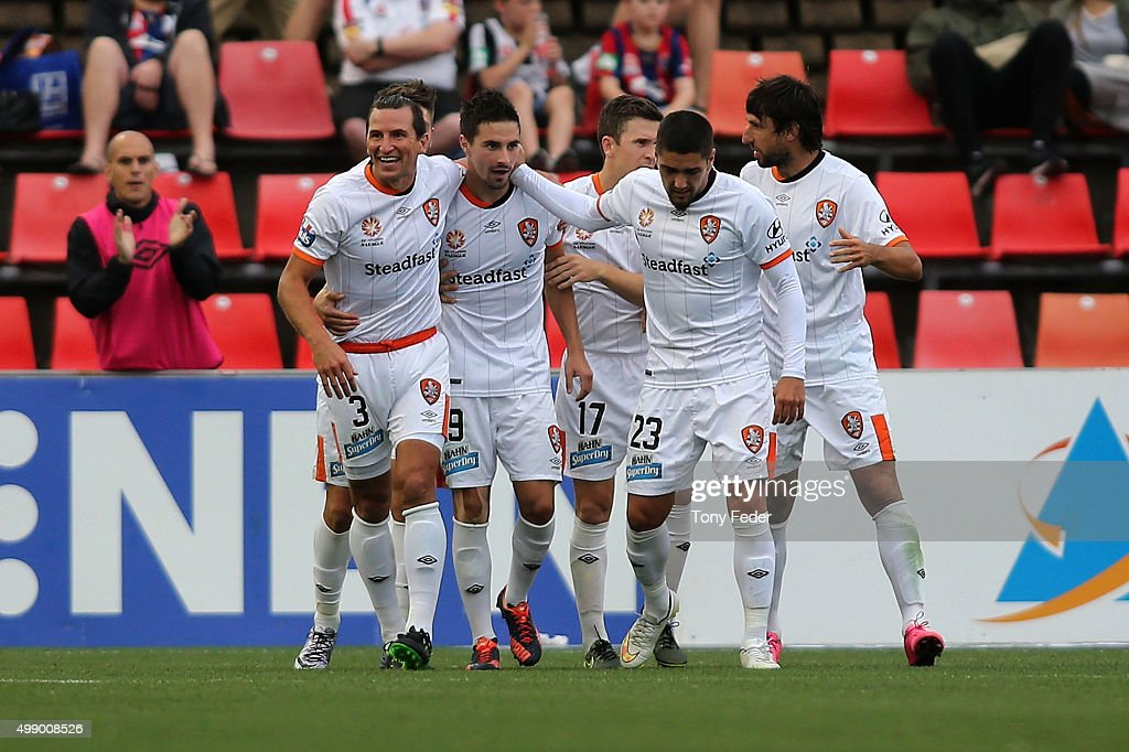 Brisbane Roar players celebrate a goal during the round eight A-League match between the Newcastle Jets and Brisbane Roar at Hunter Stadium on November 28, 2015 in Newcastle, Australia.