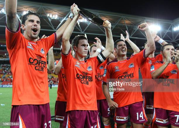 Brisbane Roar players celebrate after winning the Premiership Plate at Suncorp Stadium on February 12 2011 in Brisbane Australia