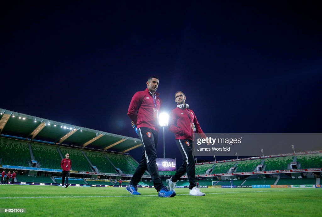 Brisbane Roar players walk back to the change rooms after pitch inspection during the round 27 A-League match between the Perth Glory and the Brisbane Roar at nib Stadium on April 14, 2018 in Perth, Australia.