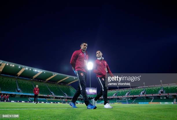 Brisbane Roar players walk back to the change rooms after pitch inspection during the round 27 ALeague match between the Perth Glory and the Brisbane...