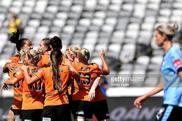 Brisbane Roar team mates celebrate a goal during the round 10 W-League match between Sydney FC and Brisbane Roar at Central Coast Stadium on December...