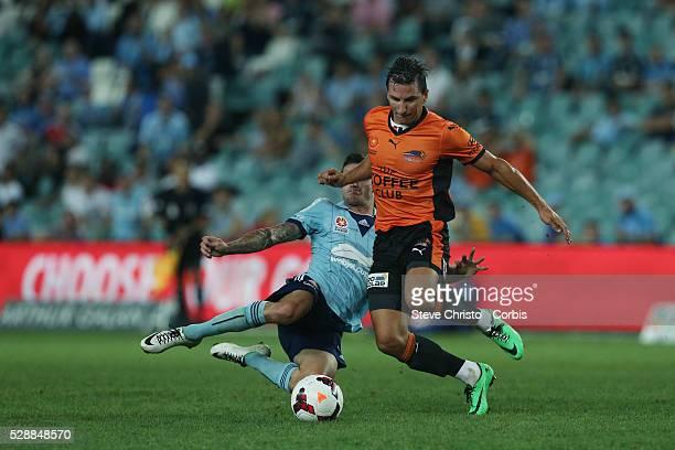 Brisbane Roars Shane Stefanutto is tackled by Sydney FC's Corey Gameiro at Allianz Stadium Sydney Australia Friday 14th March 2014