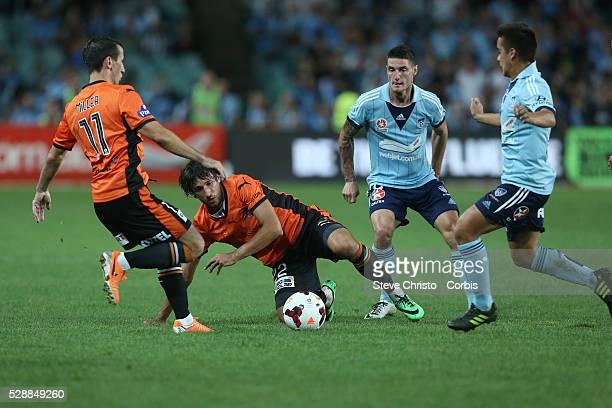 Brisbane Roars Thomas Broich falls in this challenge by Sydney FC's Corey Gameiro and Hagi Gligor at Allianz Stadium Sydney Australia Friday 14th...