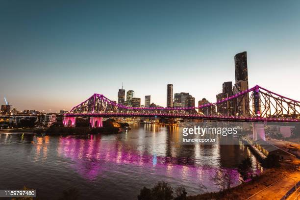brisbane skyline at dusk - australasia stock pictures, royalty-free photos & images