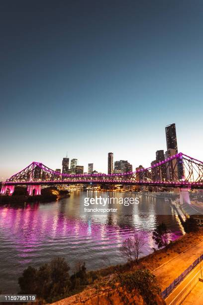 brisbane skyline at dusk - brisbane stock pictures, royalty-free photos & images