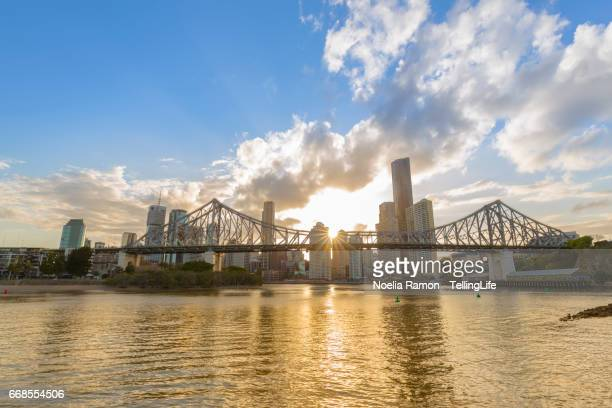Brisbane Story Bridge with the skyline and river reflection at sunset