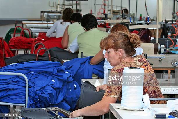 Briseida MEMA Workers sew shirts at a factory near Albania's capital Tirana on September 30, 2009. Albania's garment industry, which produces clothes...