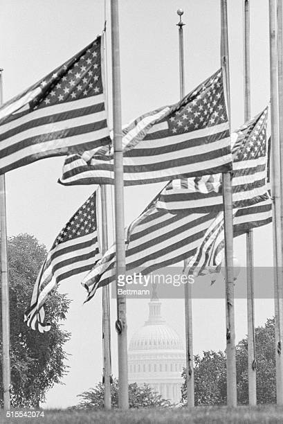 A brisk breeze whips the flags at half staff around the base of the Washington Monument 6/7 as the Nation's Capitol awaits the return of the body Sen...