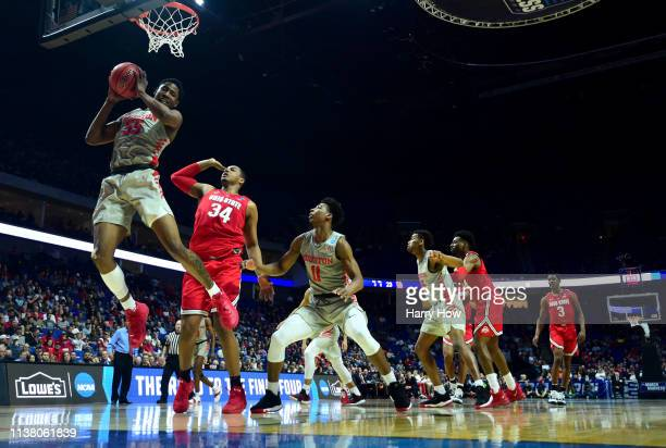 Brison Gresham of the Houston Cougars grabs a rebound against the Ohio State Buckeyes during the first half of the second round game of the 2019 NCAA...