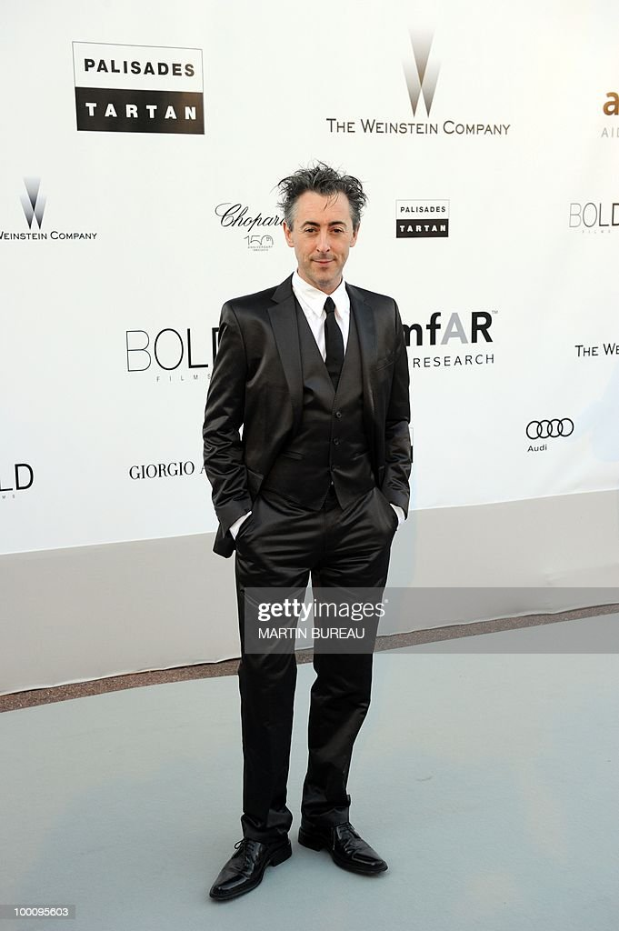 Bristish actor Alan Cumming poses while arriving at amfAR's Cinema Against Aids 2010 benefit gala on May 20, 2010 in Antibes, southeastern France.