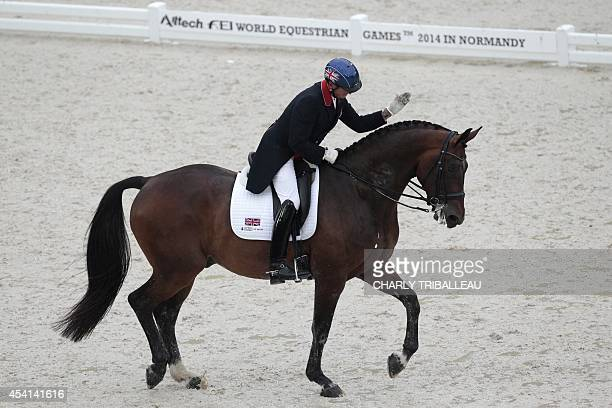 Bristish Carl Hester rides Nip Tuck on August 25 2014 during the first session of the Dressage Grand Prix of the 2014 FEI World Equestrian Games at...