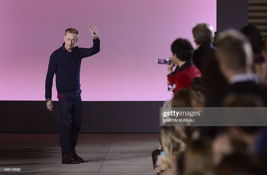Bristish designer Bill Gaytten for John Galliano acknowledges the public at the end of his Spring/Summer 2013 ready-to-wear collection show on September 30, 2012 in Paris.