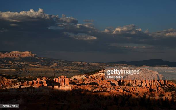 Bristlecone Point is illuminated by the setting sun above hoodoos viewed from Sunset Point overlooking Bryce Amphitheater on August 12, 2016 in Bryce...