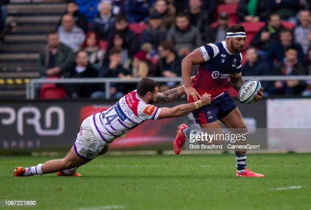 Bristol Bears' Charles Piutau evades the tackle of Leicester Tigers' Adam Thompstone during the Gallagher Premiership Rugby match between Bristol...