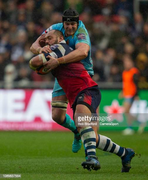 Bristol Bears' John Afoa is tackled by Exeter Chiefs' Mitch Lees during the Premiership Rugby Cup match between Bristol Bears and Exeter Chiefs at AJ...