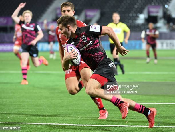 Bristol Bears scrum half Harry Randall scores a try during the European Rugby Challenge Cup final match between Toulon and Bristol Bears at the...