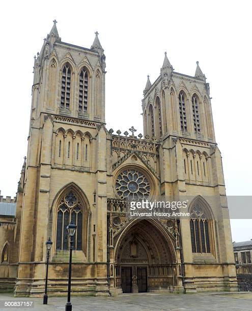Bristol Cathedral in the city of Bristol England Founded in 1140 presents a harmonious view of tall Gothic windows and pinnacle skyline that belies...