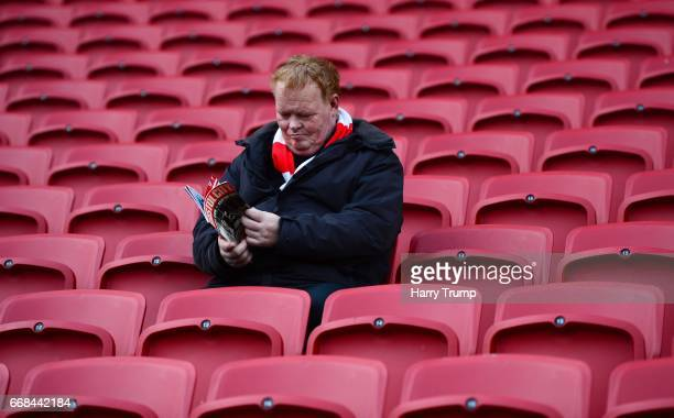Bristol City fan reads a match day programme during the Sky Bet Championship match between Bristol City and Queens Park Rangers at Ashton Gate on...