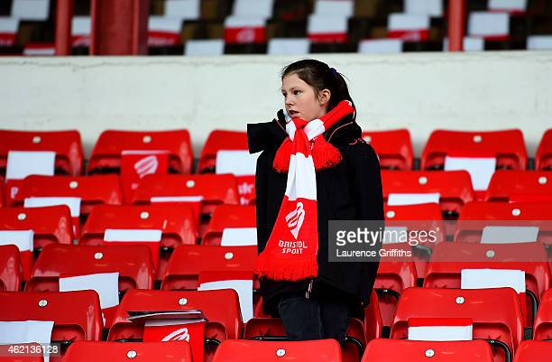 Bristol City fan waits inside the stadium for the start of the FA Cup Fourth Round match between Bristol City and West Ham United at Ashton Gate on...