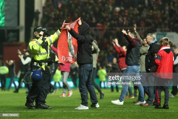 Bristol City fans are filmed by police at the end of the Carabao Cup QuarterFinal match between Bristol City and Manchester United at Ashton Gate on...