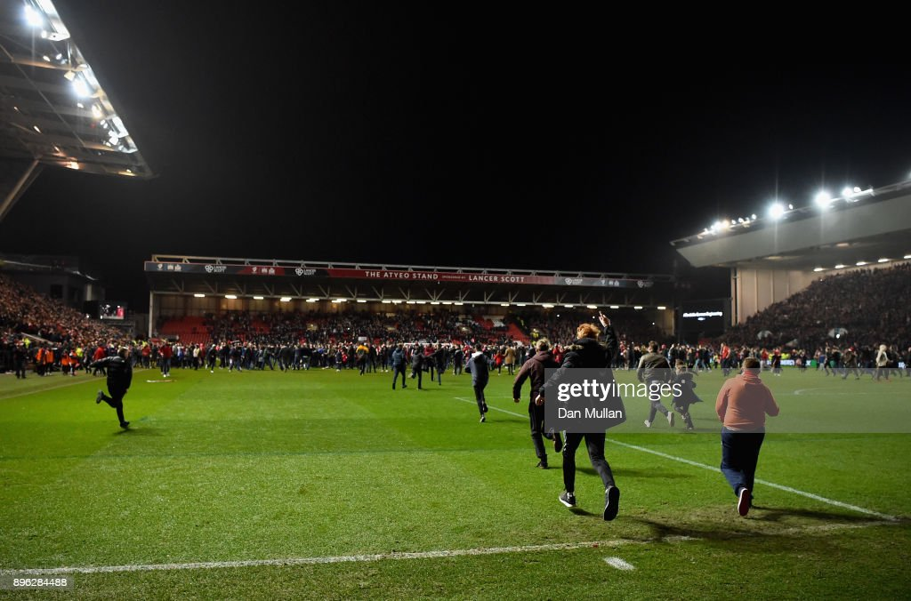 Bristol City fans invade the pitch after the Carabao Cup Quarter-Final match between Bristol City and Manchester United at Ashton Gate on December 20, 2017 in Bristol, England.