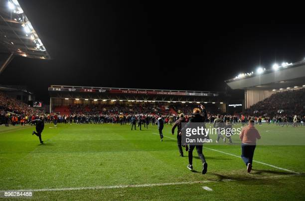 Bristol City fans invade the pitch after the Carabao Cup QuarterFinal match between Bristol City and Manchester United at Ashton Gate on December 20...