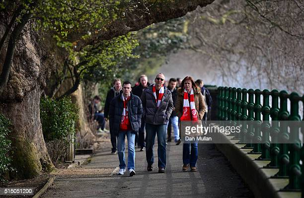 Bristol City fans make their way to the ground prior to the Sky Bet Championship match between Fulham and Bristol City at Craven Cottage on March 12...