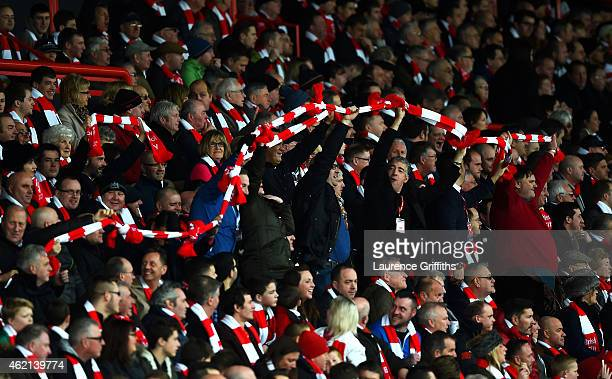 Bristol City fans tie their scarves together as they show their suport during the FA Cup Fourth Round match between Bristol City and West Ham United...