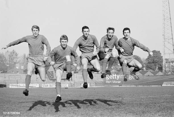 Bristol City FC soccer players Jantzen Derrick, John Giles, Dick Down, Gerrry Sharpe, Danny Bartley jumping together during a training session, UK,...