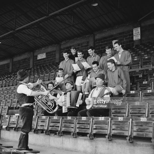 Bristol City FC soccer players rehearsing club song with English singer Adge Cutler and The Wurzels, Bristol, UK, 16th February 1967.