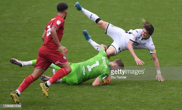 Bristol City goalkeeper Daniel Bentley challenges Swansea player Conor Gallagher during the Sky Bet Championship match between Swansea City and...