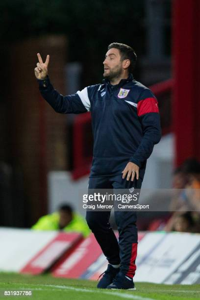 Bristol City manager Lee Johnson shouts instructions to his team from the dugout during the Sky Bet Championship match between Brentford and Bristol...