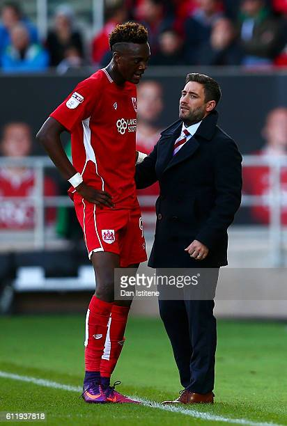 Bristol City manager Lee Johnson speaks with Tammy Abraham of Bristol City during the Sky Bet Championship match between Bristol City and Nottingham...