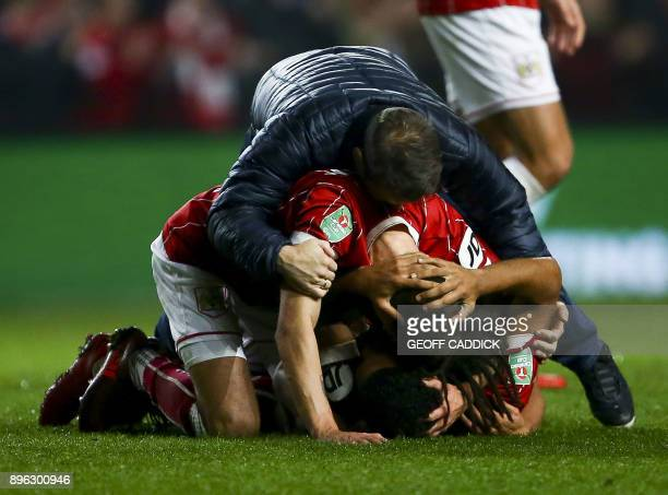 Bristol City players celebrate their victory after the English League Cup quarterfinal football match between Bristol City and Manchester United at...